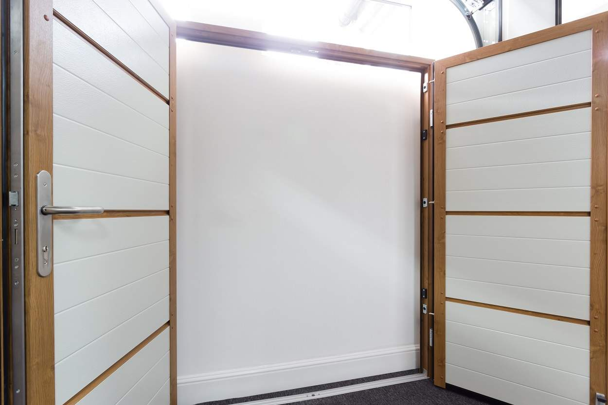 showroom with white double garage doors
