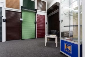 showroom with waiting area and lots of different coloured roller shutters