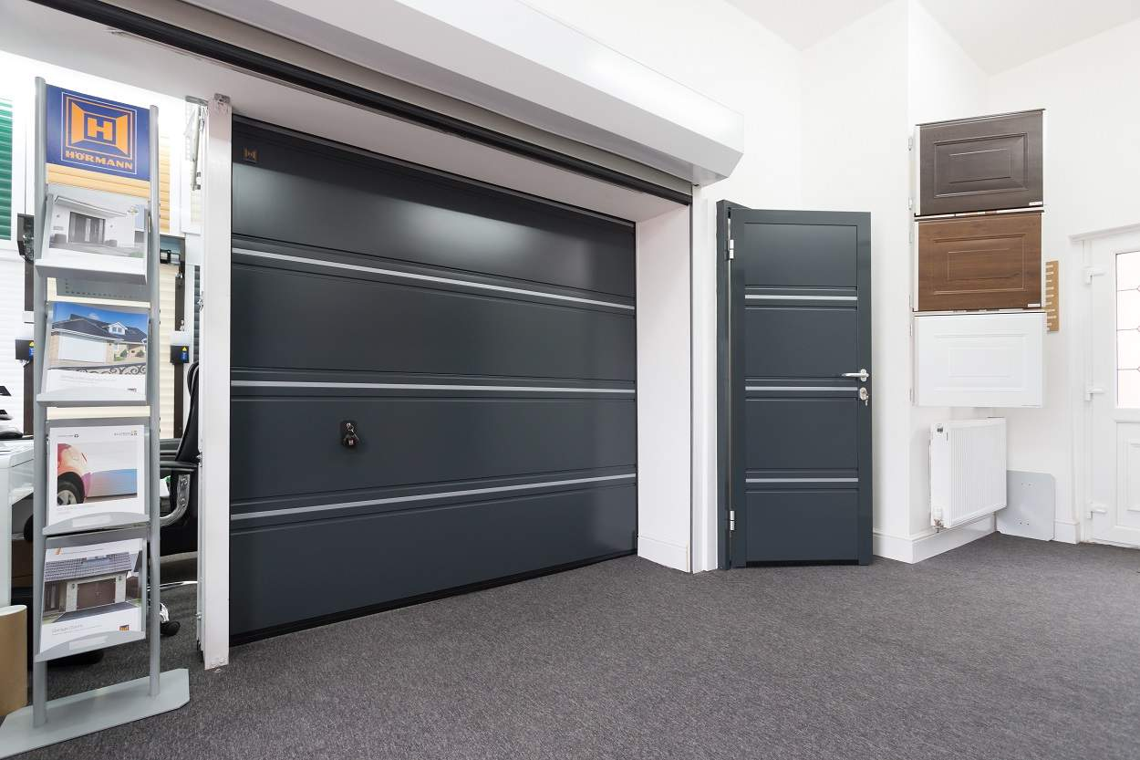 showroom with grey garage door, grey security door, samples and brochures