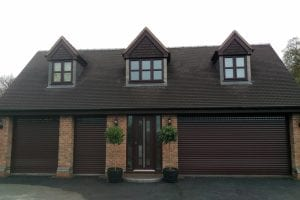brown electric roller shutters across front of a house