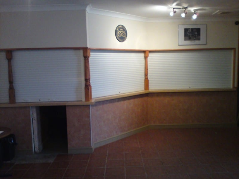 white electric roller shutters on bar