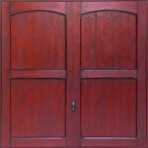 GRP Up and Overs garage door in a dark red wood colour.