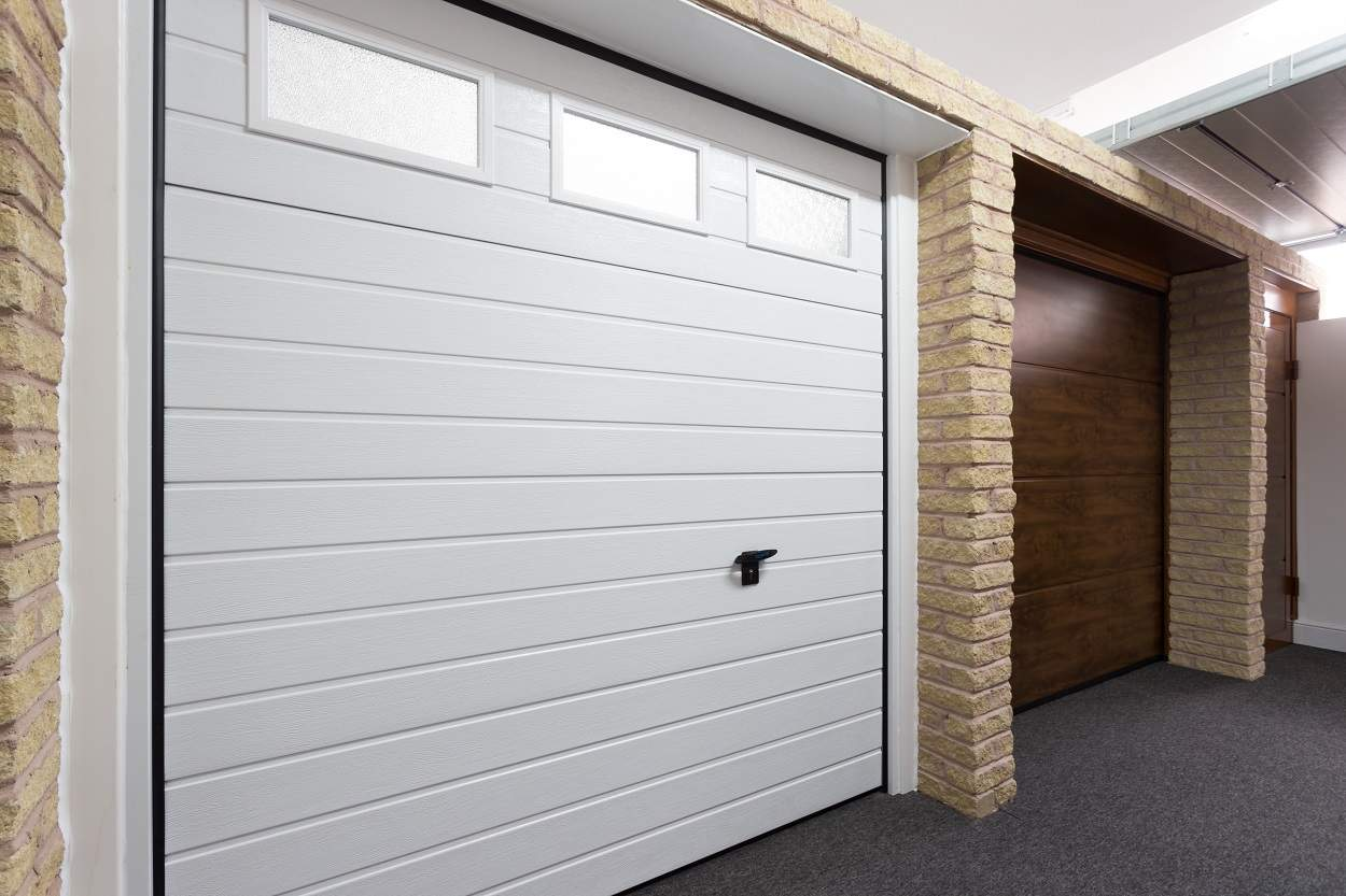 white panelled garage door with glass and brown panelled garage door