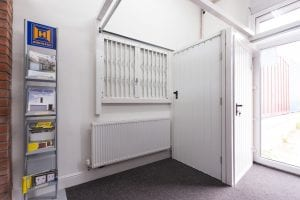 showroom with white shutters, white security doors and brochures