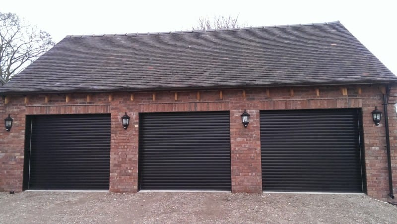 three black electric roller garage doors