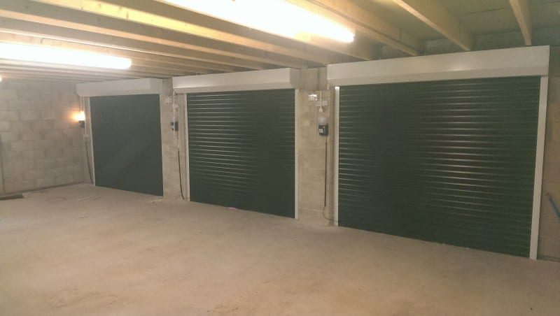 three electric roller garage doors