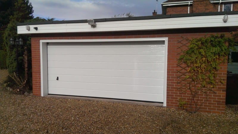 white sectional double garage door