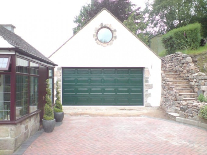 green sectional double garage door