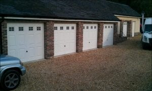 five white up and over garage doors
