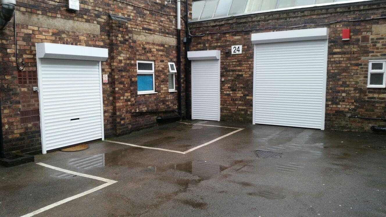 3 out of 5 Externally fitted white roller shutter doors for Terrfix