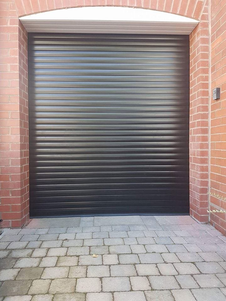 Electrically operated roller door powder coated black