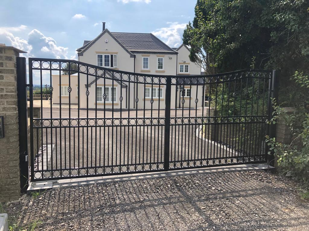 Wrought iron driveway gate is automated and galvanised to a beautiful spec