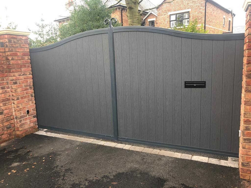 Powder coated driveway gate has been beautifully designed with a composite infill