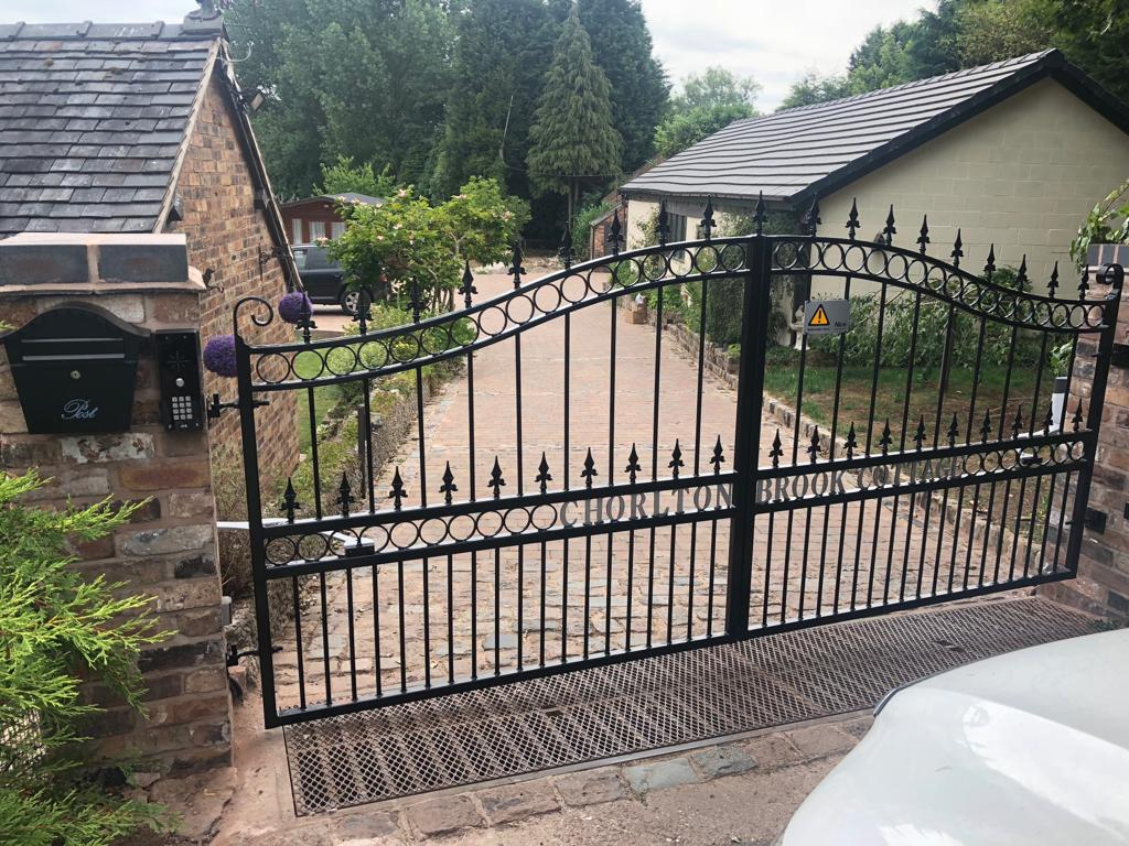 AD Ruby - A motorised wrought iron driveway gate, galvanised and powder coated black with silver wording