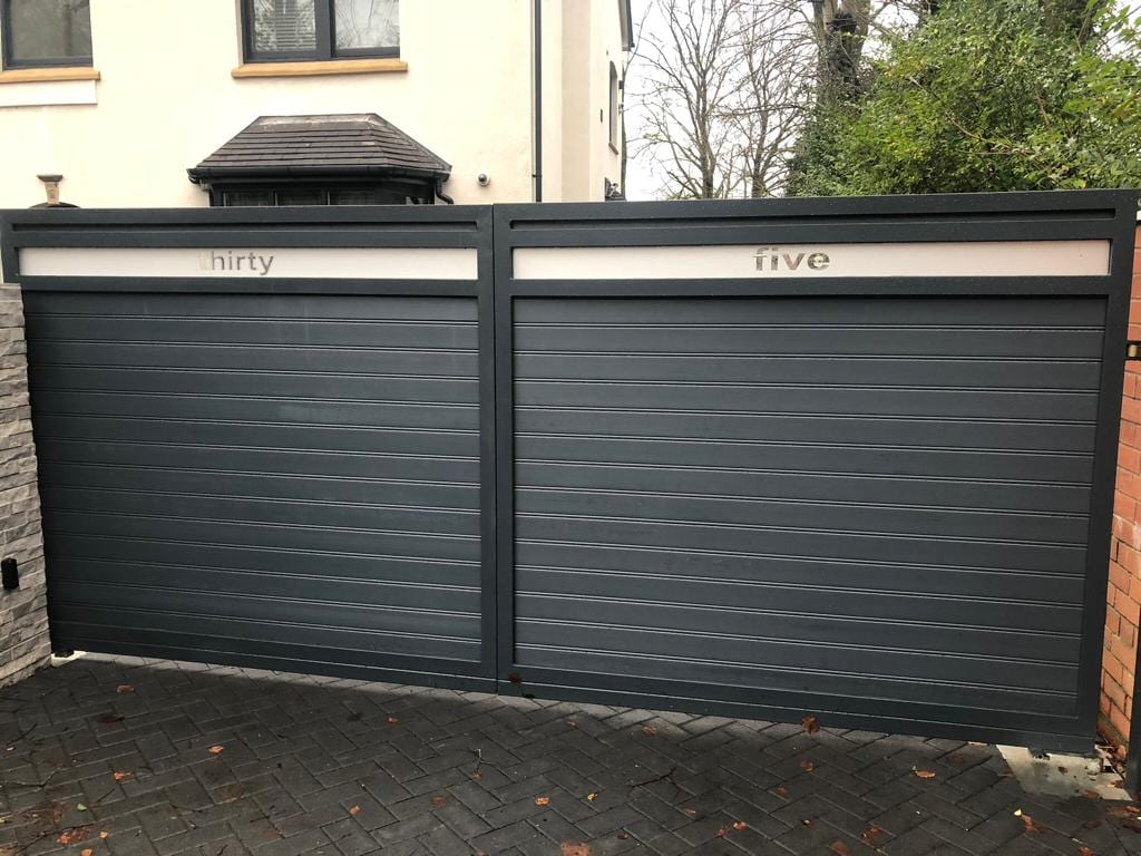 Powder coated driveway gate with composite infill