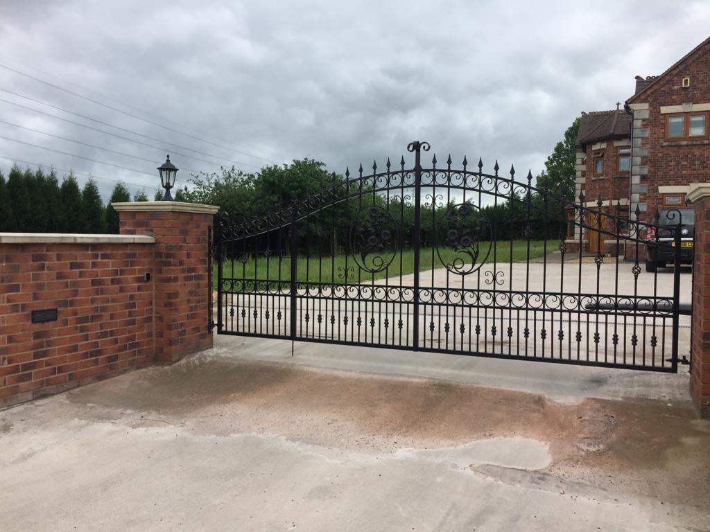 Wrought iron driveway gate, galvanised, powder coated and motorised.