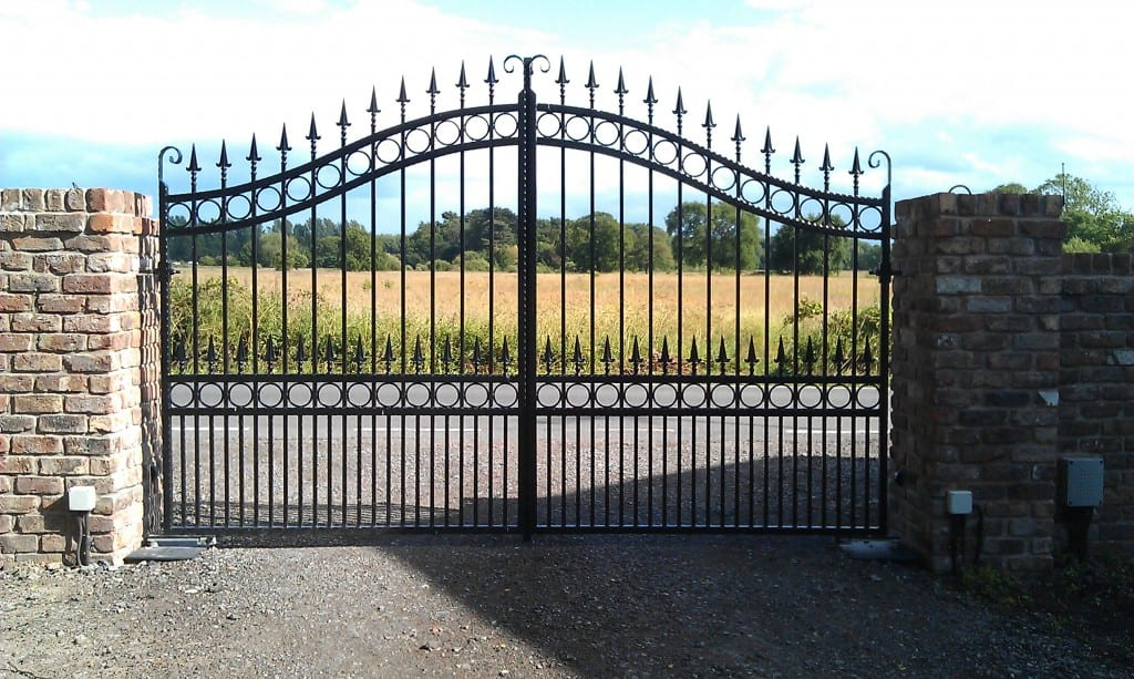 A motorised wrought iron, powder coated driveway gate- galvanised.