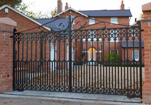Automated driveway gate. Beautifully styled wrought iron, galvanised and powder coated black