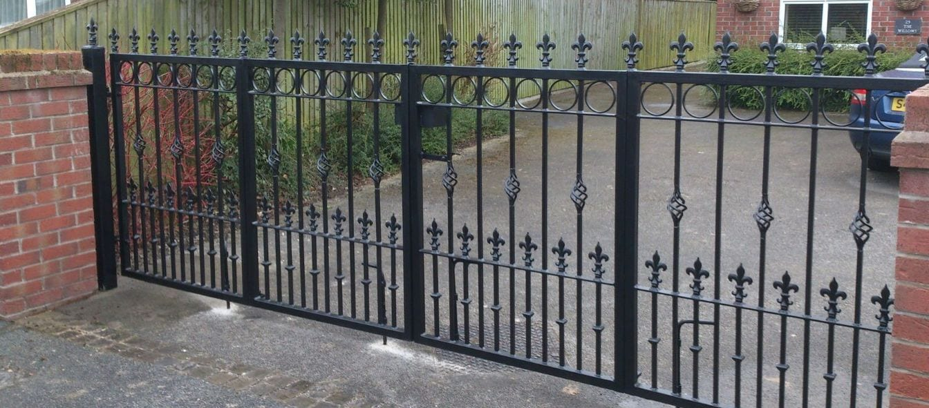 AD Alton - A manual wrought iron driveway gate, galvanised with a black powder coat to finish.