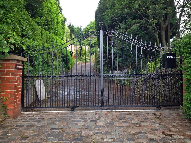 AD Pinewood - A stylish black powder coated driveway gate in wrought iron- galvanised
