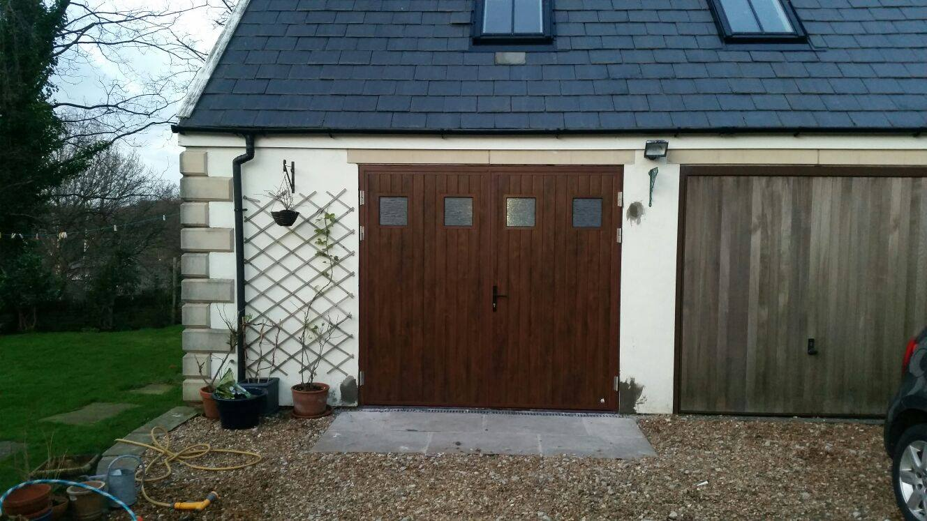 A 50/50 split side hinged garage door with windows