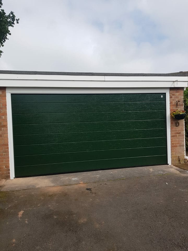 1 x Alutech double sectional garage door in an M ribbed pattern powder coated fir green with a white surround