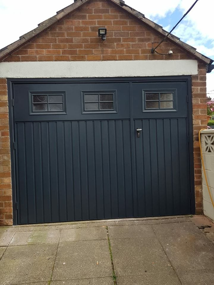 Fort side hinged garage door in a Chester small rib, vertical with windows