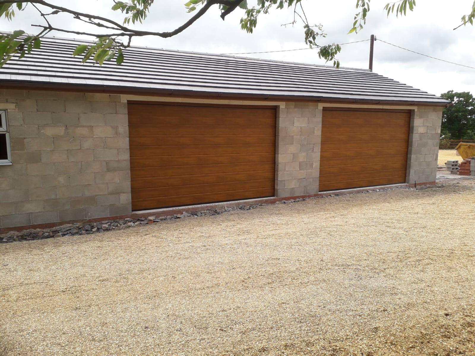 2 x M ribbed sectional garage doors in golden oak