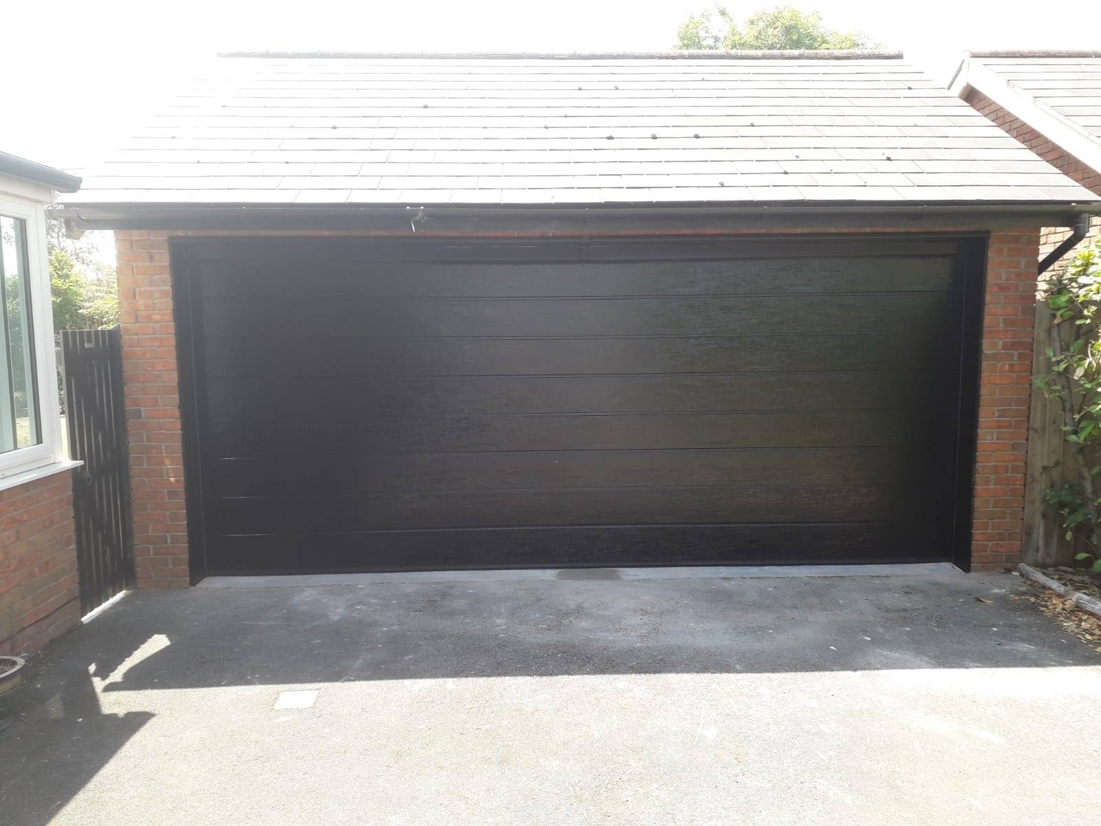 1 x double sectional garage door, powder coated black with a matching surround
