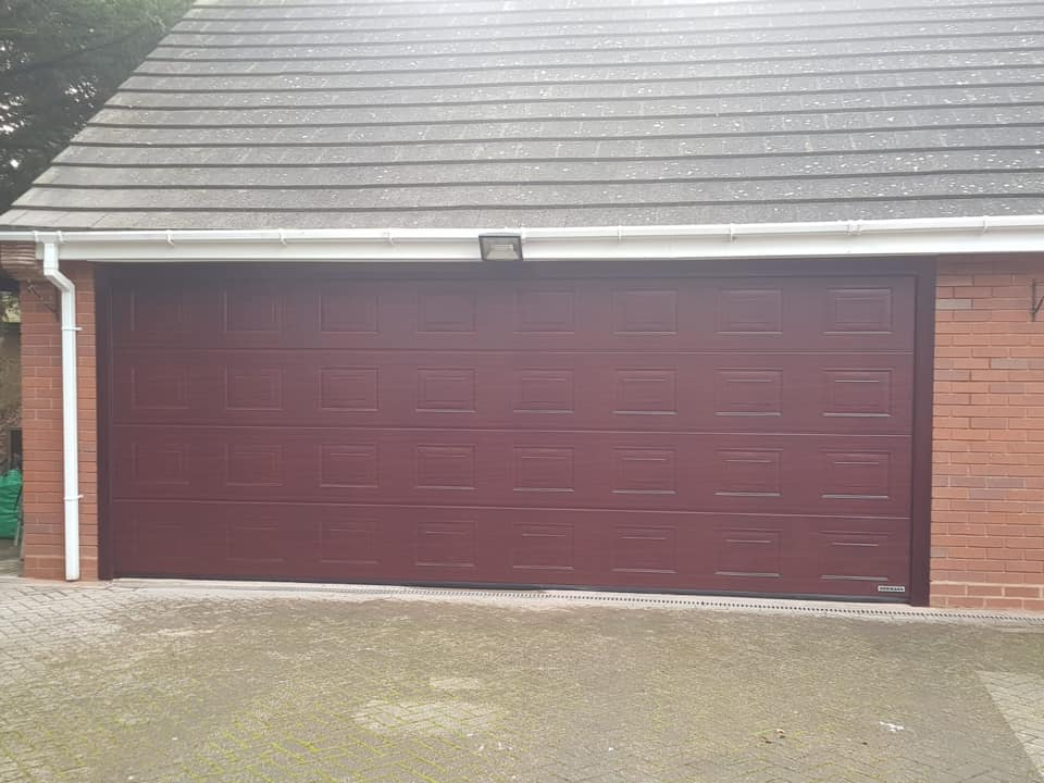 1 x double sectional garage door in a georgian pattern, powder coated rosewood in a deco-grain finish