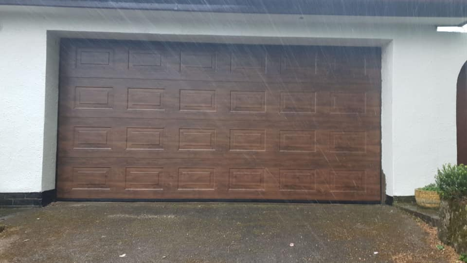 Double Alutech sectional garage door in Georgian design in Dark Oak, Woodgrain effect with matching tracks complete with NRG Black Edition motor and 2 x remote controls.