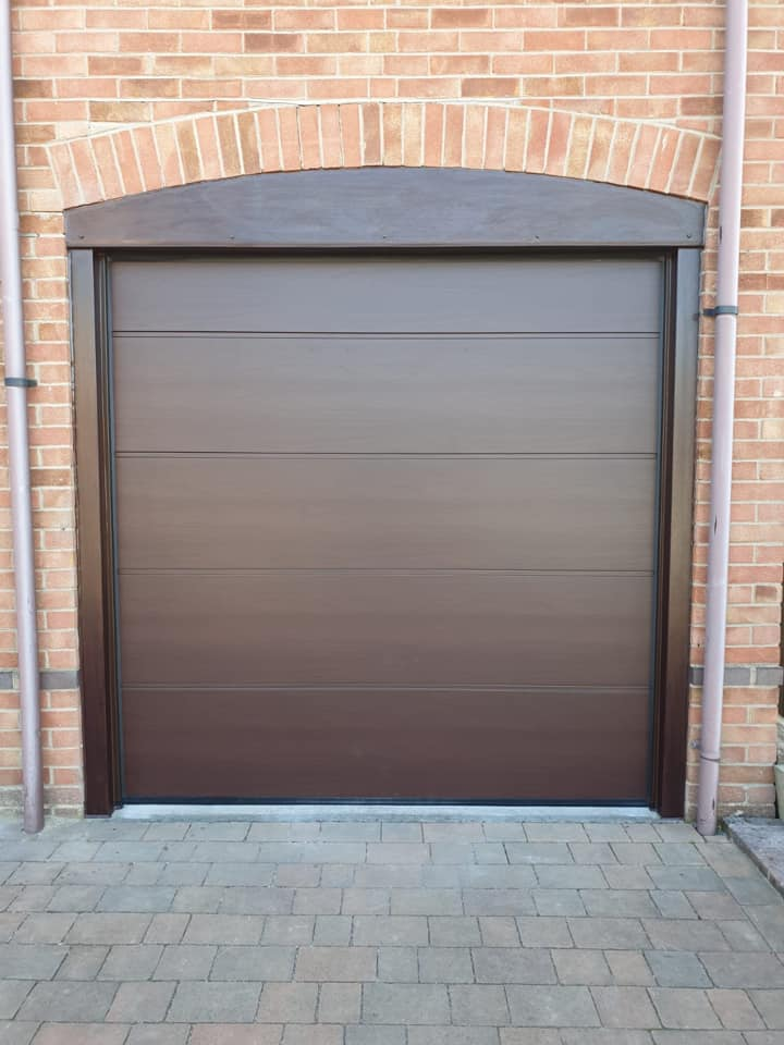 1 x Alutech sectional garage door in an L ribbed pattern and a rosewood finish.