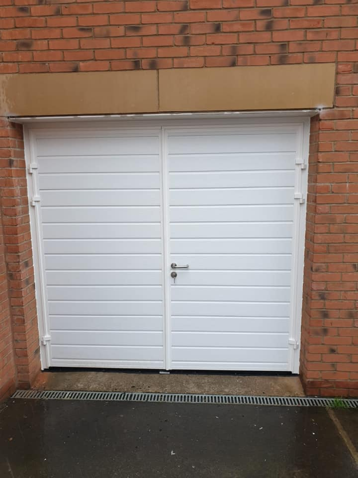 A lovely pair of carteck insulated side hinge garage doors in standard horizontal rib in white with wood grain effect. Supplied and installed in