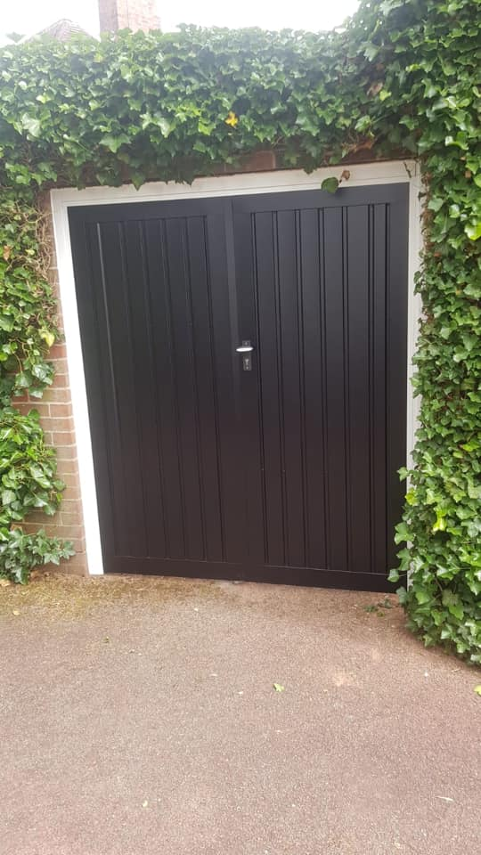 1 pair of Fort side hinged garage doors with a 50/50 split. Drayton vertical design in black completed with a white frame.