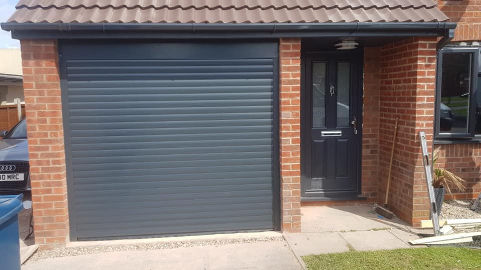Electrically operated Stylish Roller door in Anthracite Grey with a matching surround. Complete with 2 x remote units.