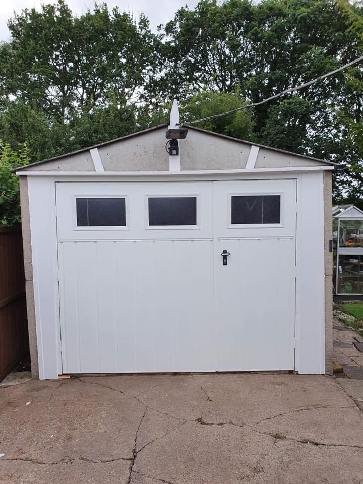 Pair of fort side hinged garage doors with a 1/3rd and 2/3rd split. Chester design with Stockton cross windows, medium vertical design in white. complete with matching frame.
