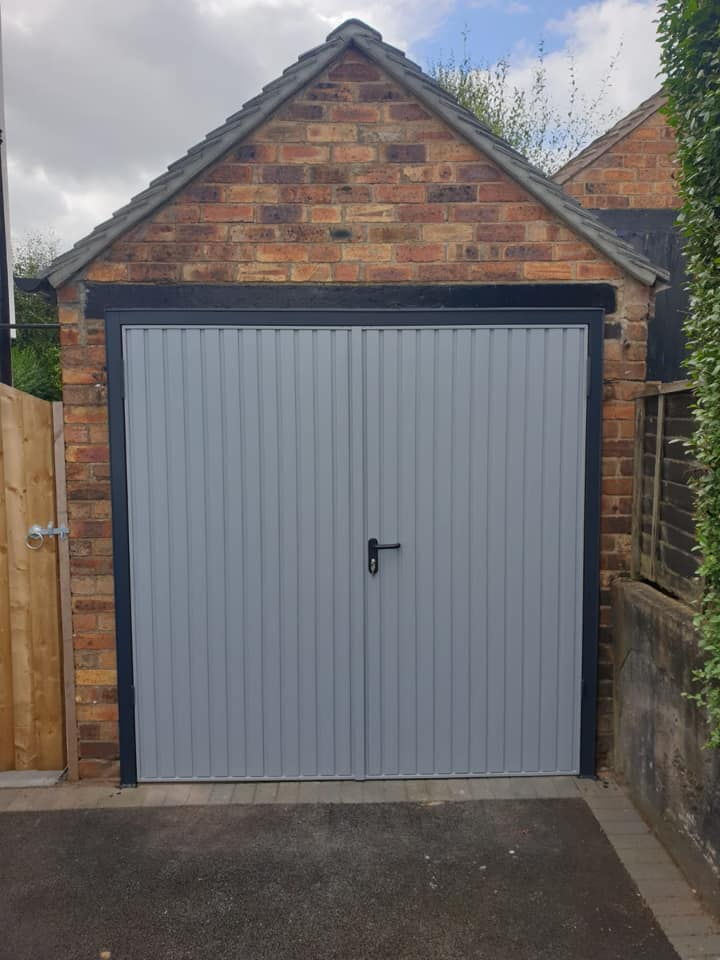 1x pair of Garador side hinged garage doors with a 50/50 split. Standard vertical design in window grey with an anthracite grey frame. Manually operated via standard locking.