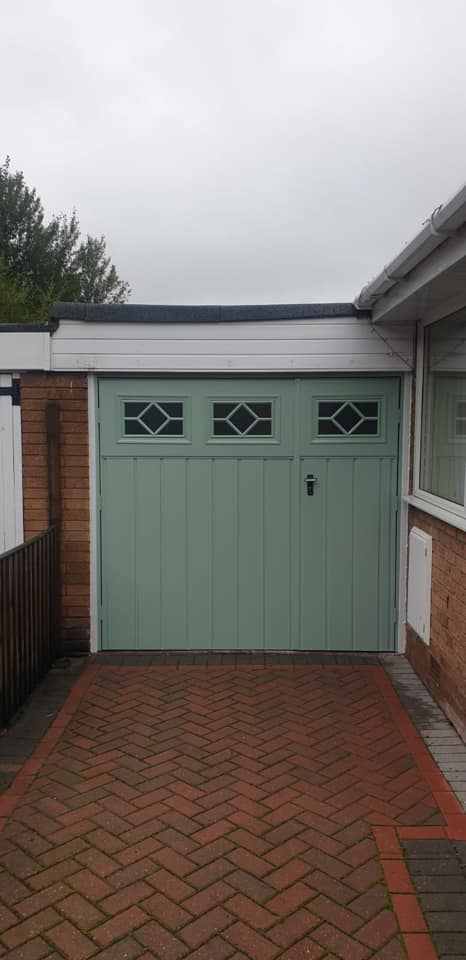 1 pair of fort side hinged garage doors in chartwell green with a 1/3rd, 2/3rd split. This is a Chester medium vertical style complete with frosted, diamond windows.