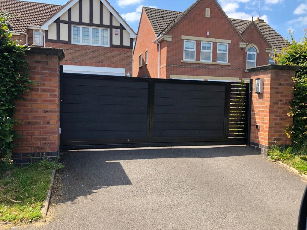 A contemporary, motorised, composite infill driveway gate finished to a high spec