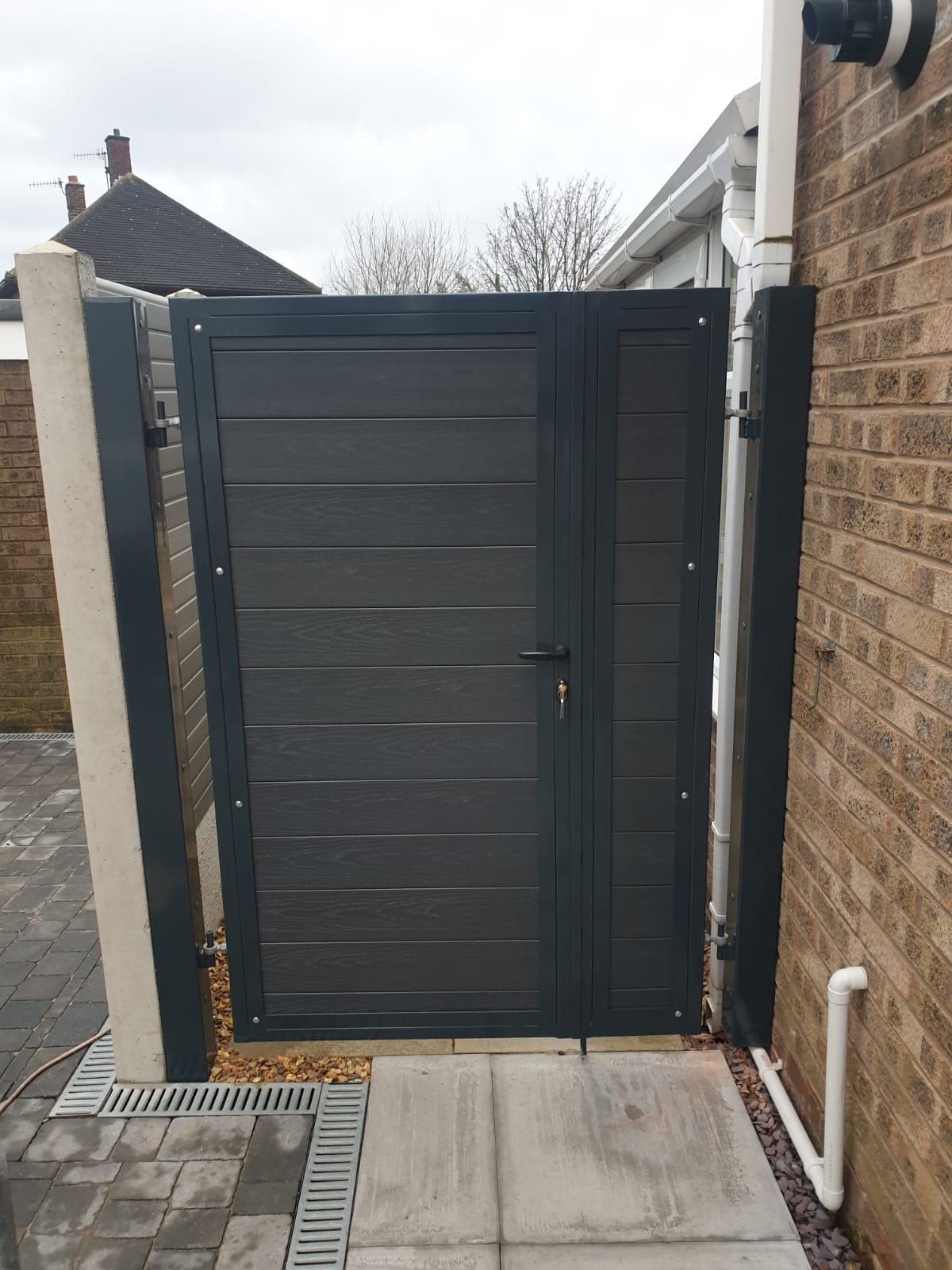 Saphire - Pedestrian gate with a composite infill, powder coated in anthracite grey with an infill panel to match