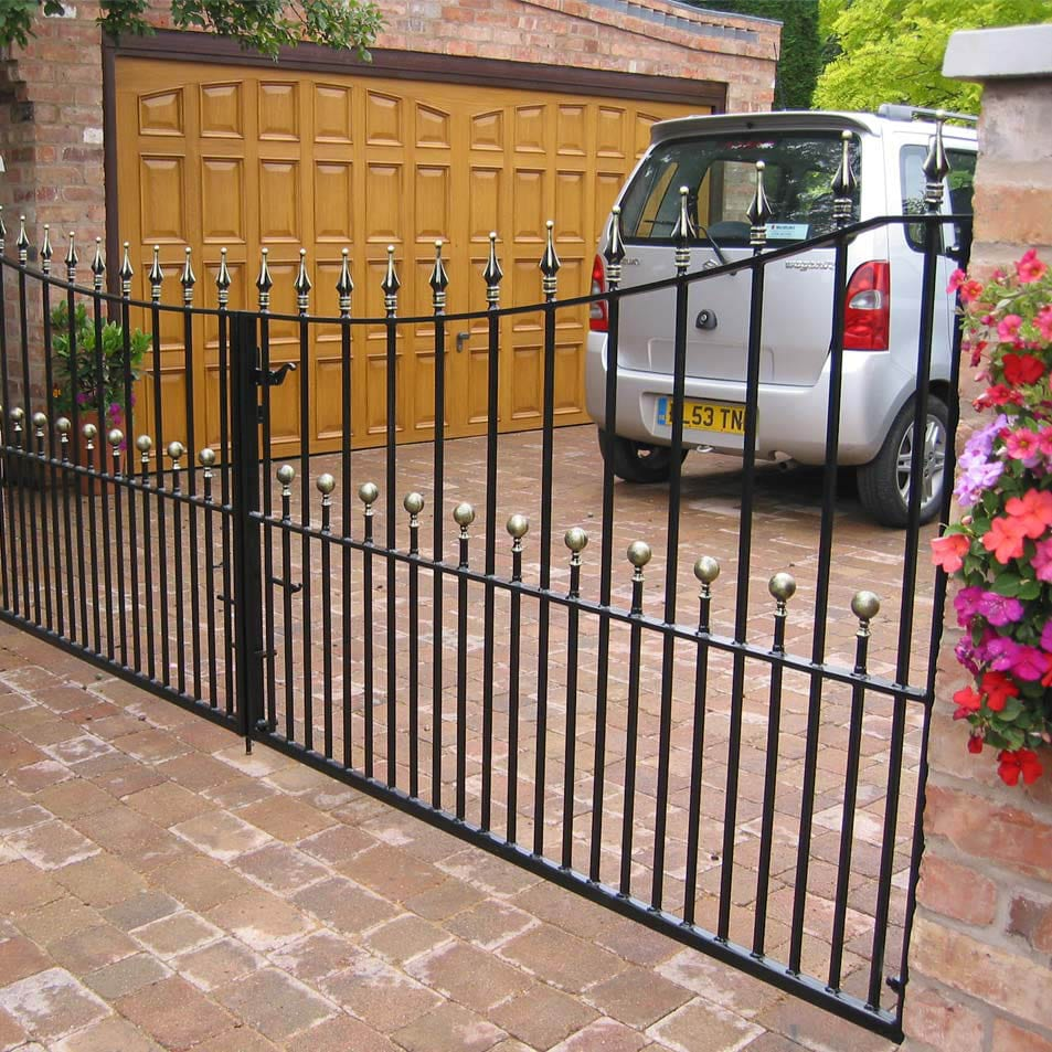 An attractive manual wrought iron driveway gate, powder coated and galvanised