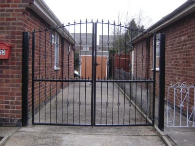 A manual wrought iron driveway gate, galvanised and powder coated
