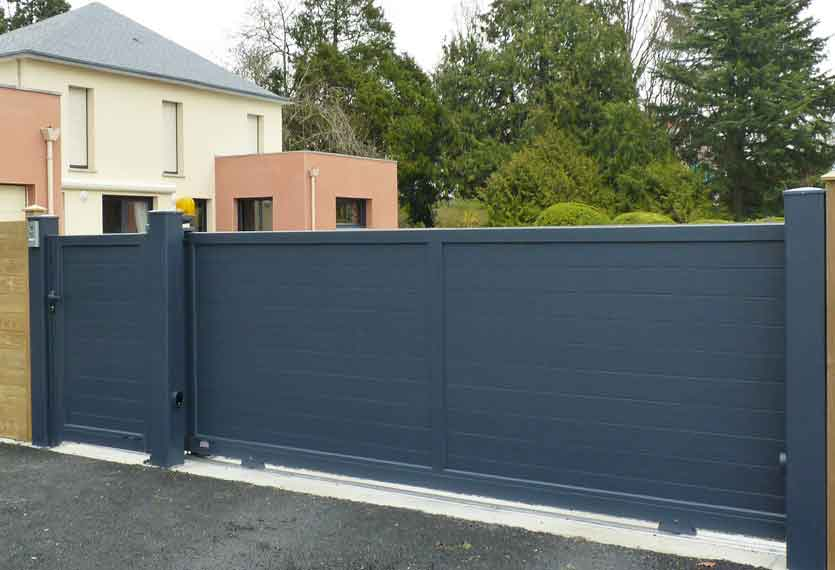 Horizal- A contemporary, aluminium sliding gate with a painted pedestrian gate to match