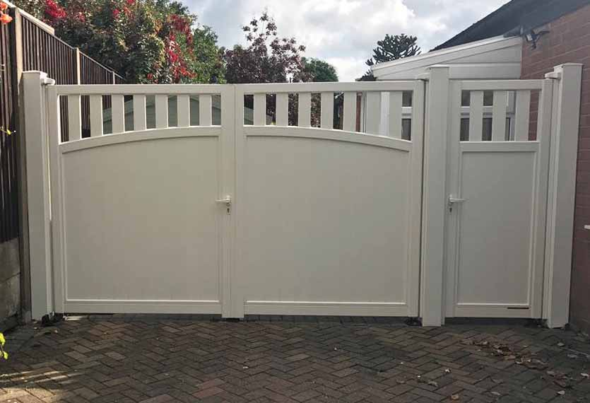 Horizal- A contemporary painted solor aluminium swing gate with a pedestrian door to match