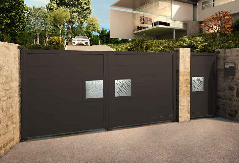 Horizal- night and day aluminium gates. A unique LED lighting system set up to your smart device which enables you to change colours and patterns on your gate design.