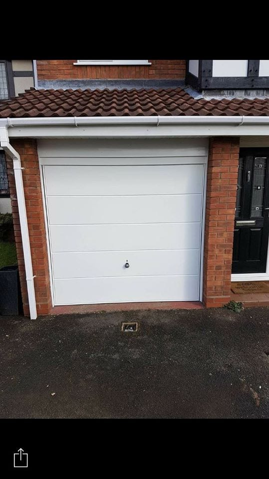 Hormann Finesse up and over garage door in a powder coated white finish