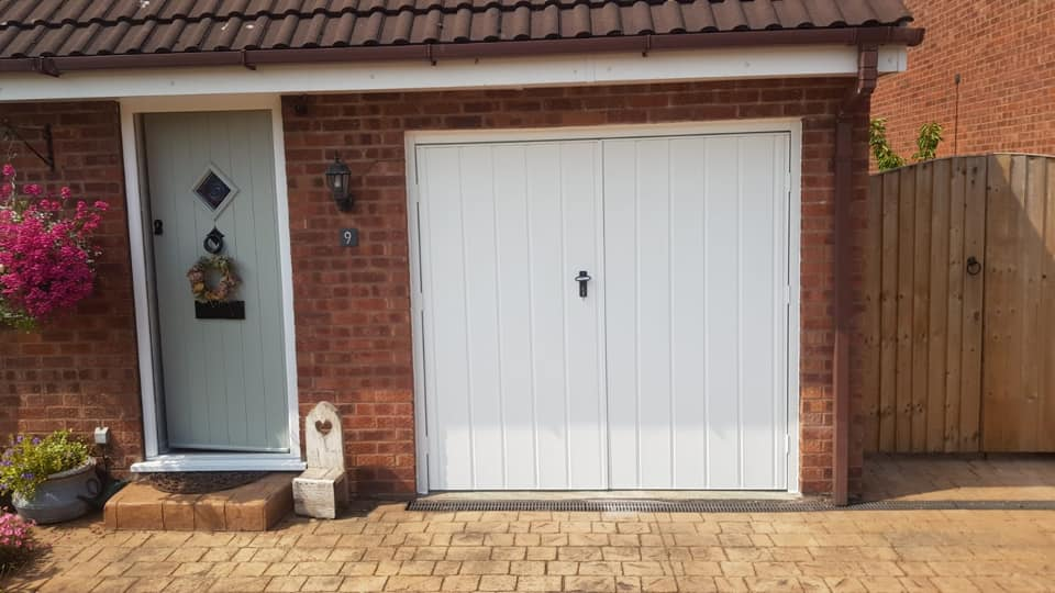 A pair of medium vertical Fort side hinged garage doors fitted with a 50/50 split in powder coated white finish.