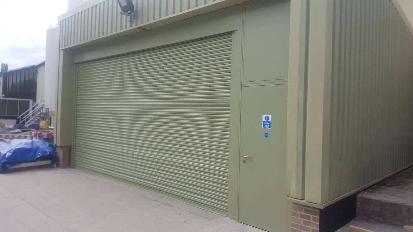 Industrial 3 phase roller shutter with a matching security side door