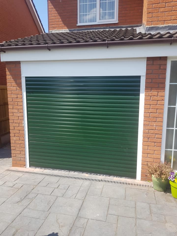 77mm Stylish roller door in Moss Green with a white kit, complete with 2 x remote controls.