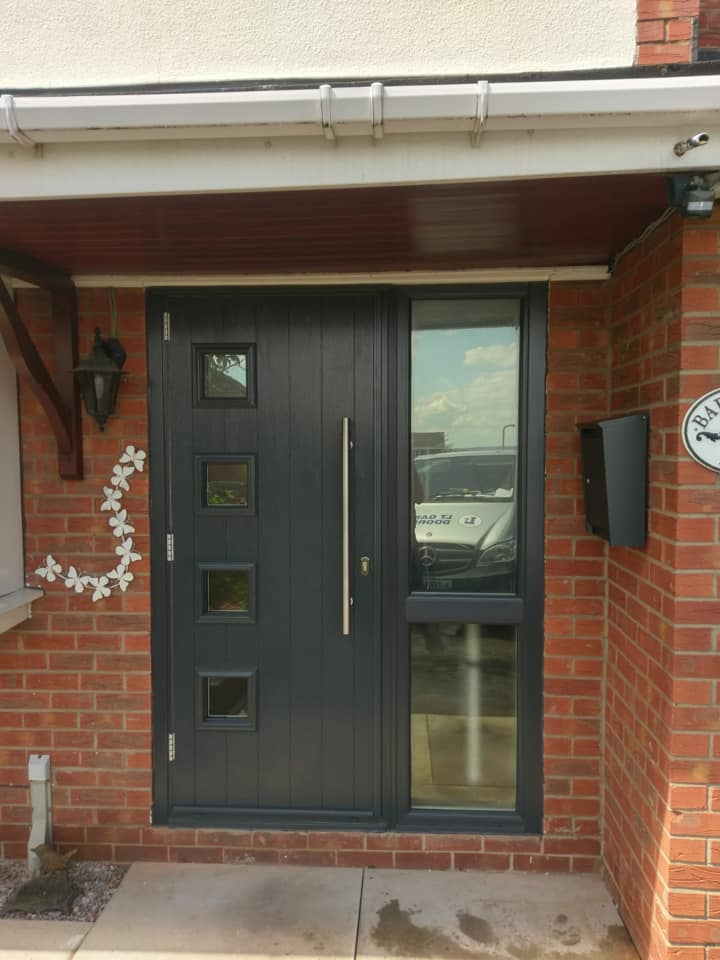Solidor, Milando design front entrance door in Anthracite Grey, White on the inside with a White frame. Stippolite in door and a side panel finished with a chrome pull bar.
